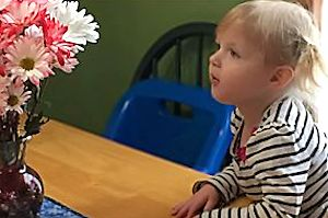 Appleton Child Care - Girl with Flowers
