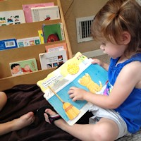 Child Care Enrollment - Child Reading
