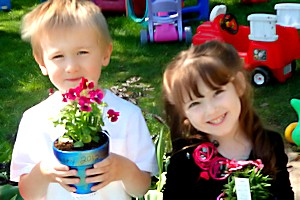 Green Child Care - Children Holding Flowers