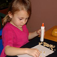 Quality Child Care Program - Girl Gluing